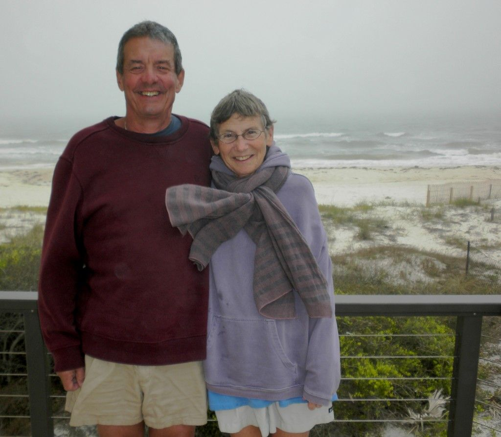 David and wife Gene smile with beach in background